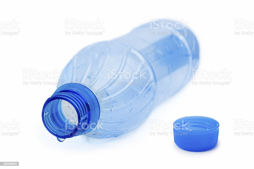 Empty blue water bottle with one drop on top  royalty-free stock photo