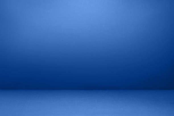 empty blue with black vignette studio well use as background. - studio shot stock pictures, royalty-free photos & images