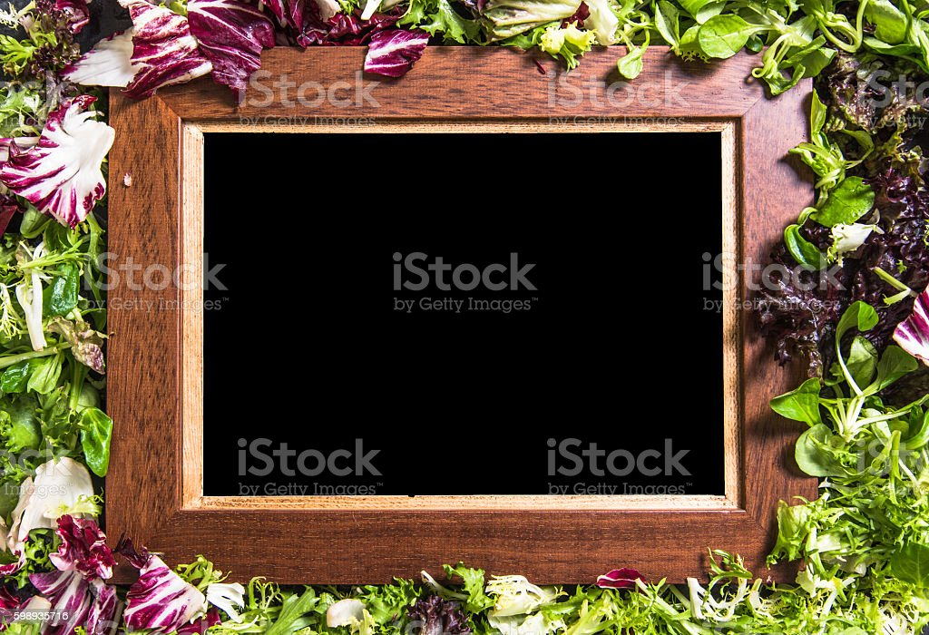 Empty board background with salad stock photo