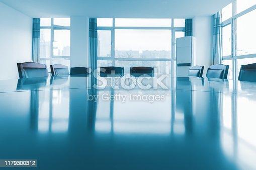 1064053478 istock photo Empty board room 1179300312