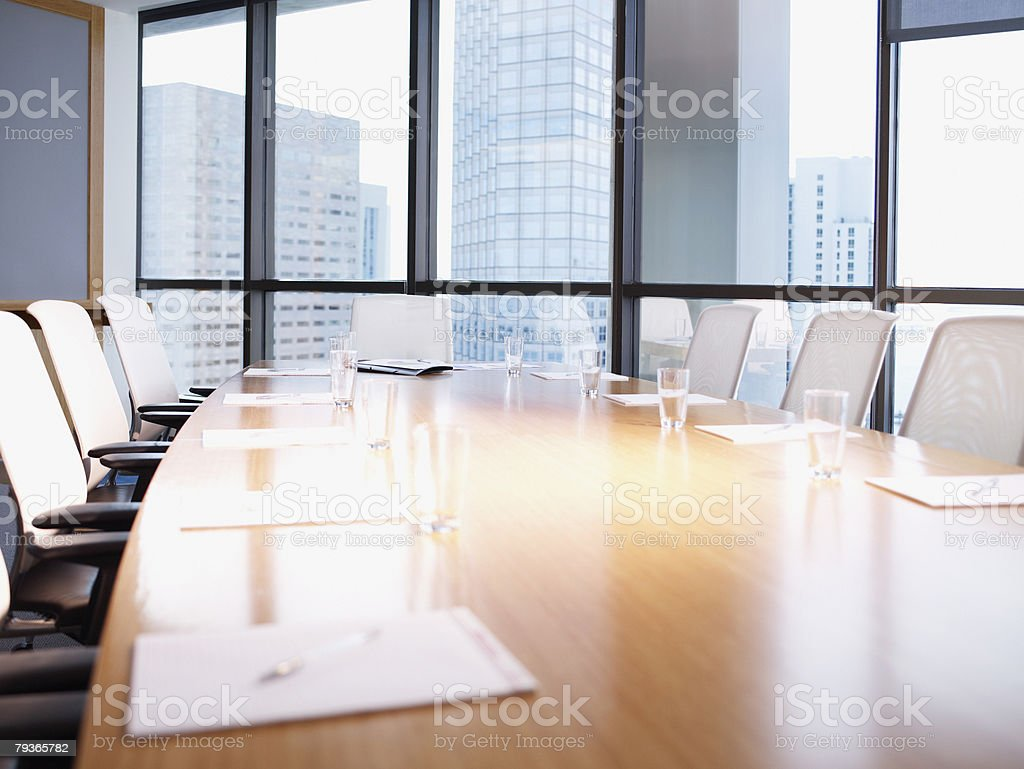Empty boardroom table with paperwork stock photo