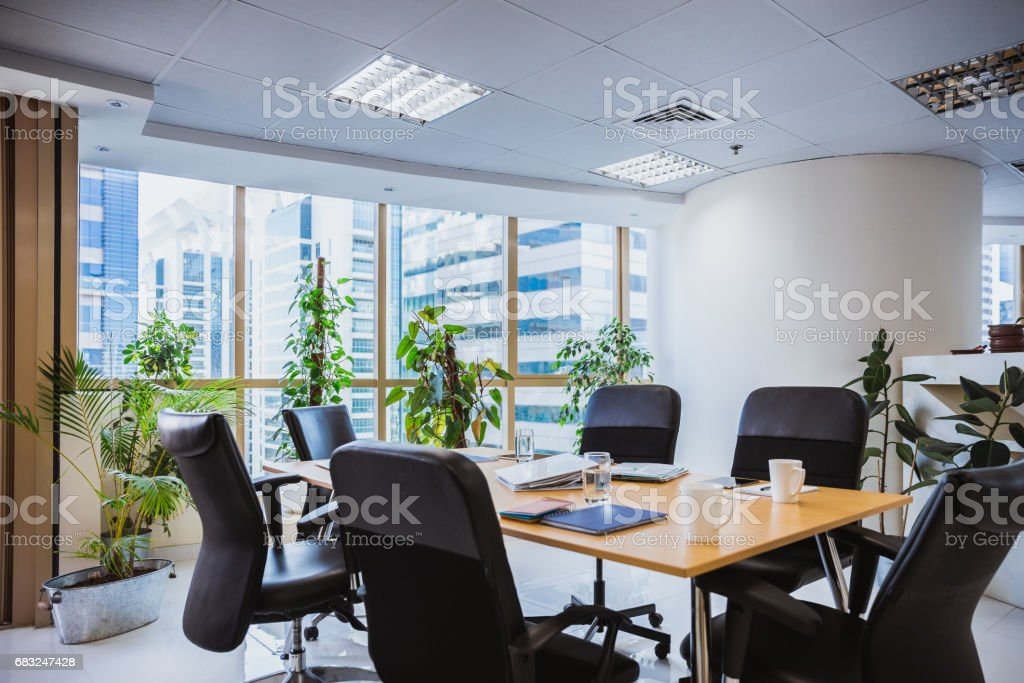 Empty Boardroom with chairs around the conference table 免版稅 stock photo