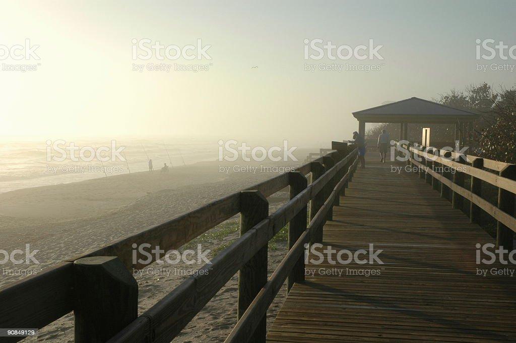 Empty boardwalk at dawn on a hazy morning stock photo