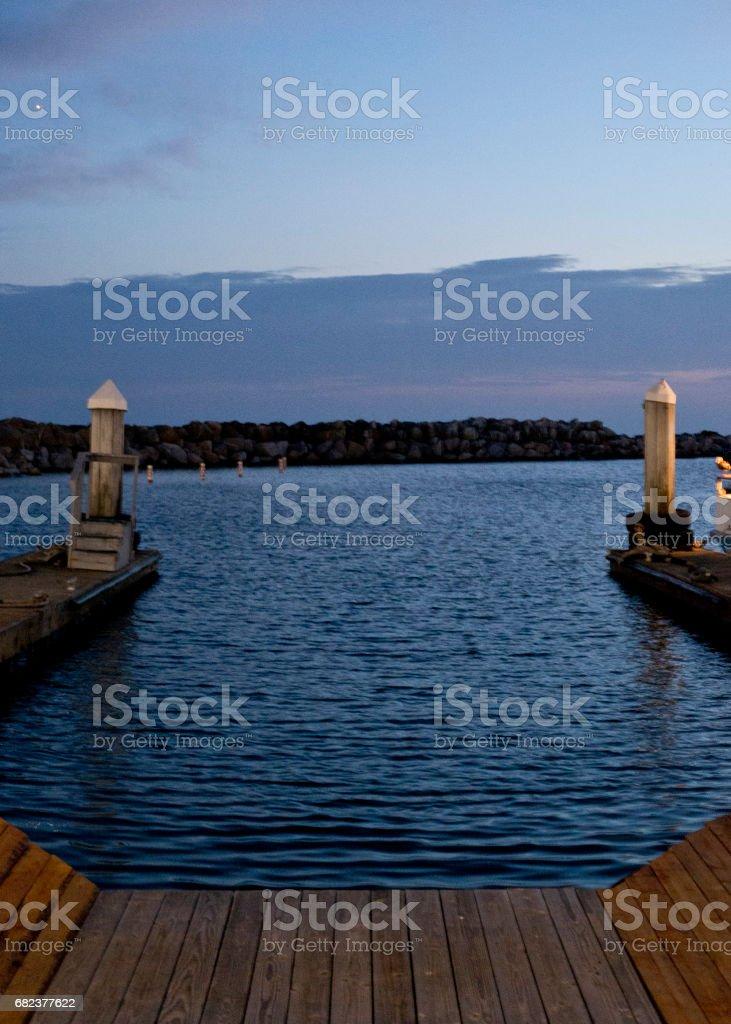 Empty Boat Slip Looking Into Ocean royalty free stockfoto