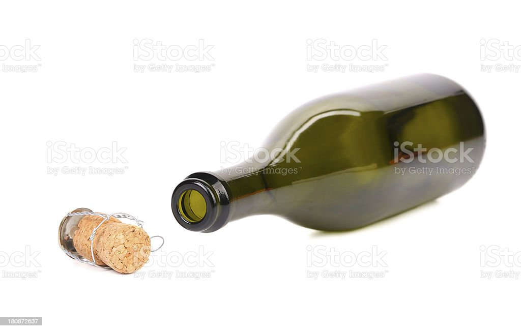 Empty bottle of champagne and muzzle with cork. royalty-free stock photo