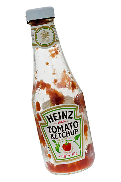 empty bottle of heinz tomato ketchup - heinz stock photos and pictures