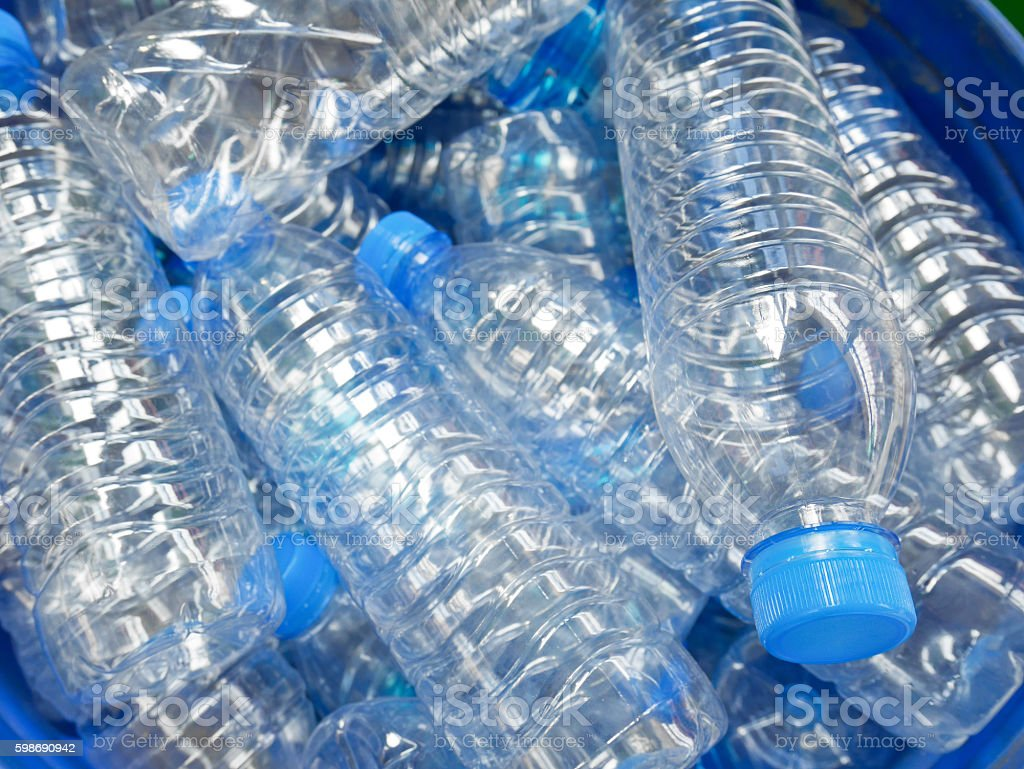 Empty bottled water in big bucket for recycling stock photo