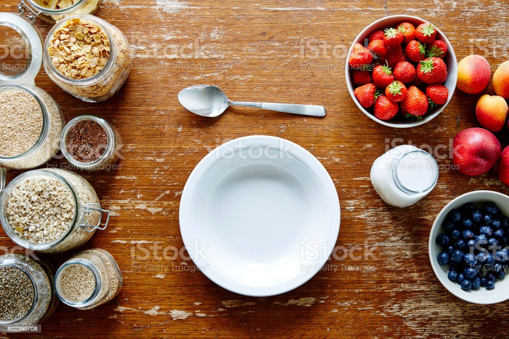 empty bowl on muesli bar organic cereal and fresh healthy fruit stock photo