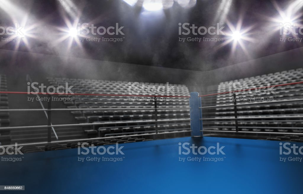 Empty boxing ring in arena, spot lights, smoke and dark night scene stock photo