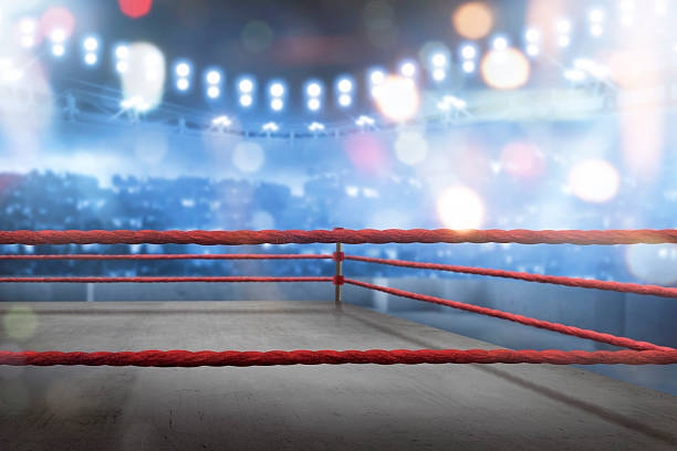 Empty boxing ring with red ropes for match - fotografia de stock