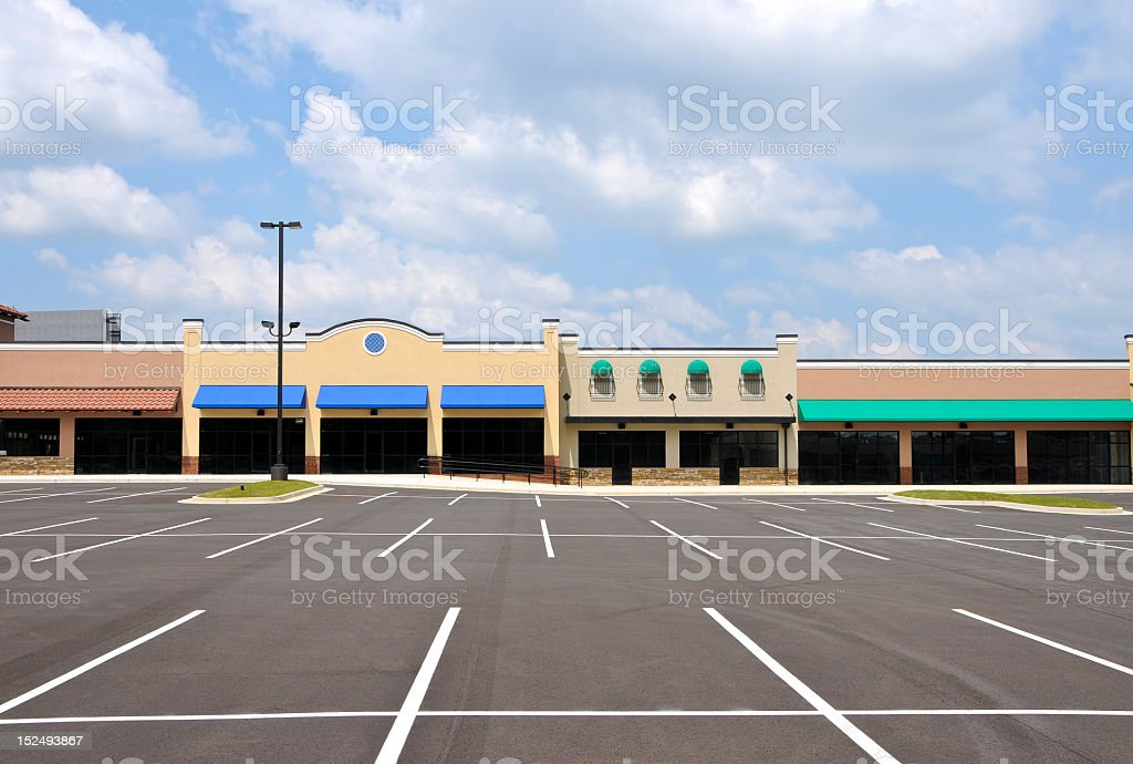 Empty brand new strip mall and parking lot stock photo