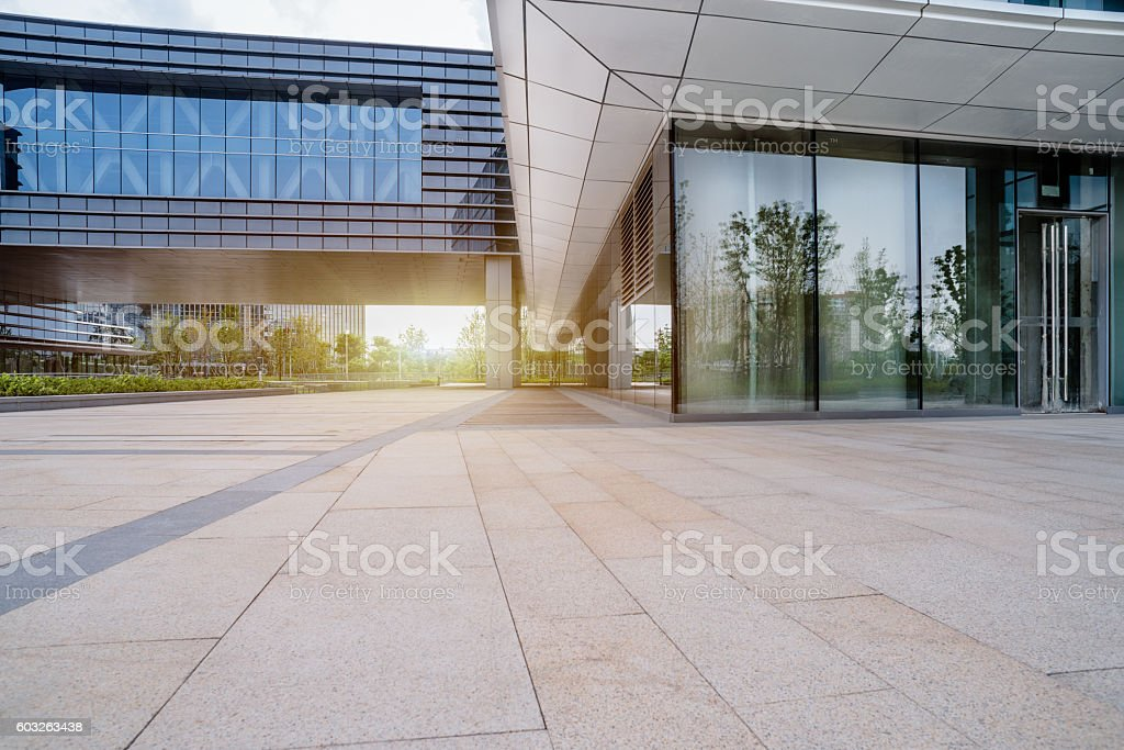 empty brick floor front of modern building stock photo