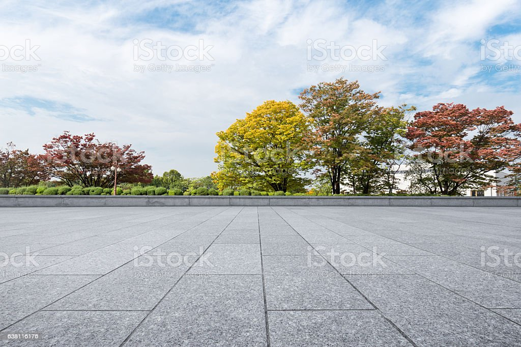empty brick floor near park in cloud sky stock photo