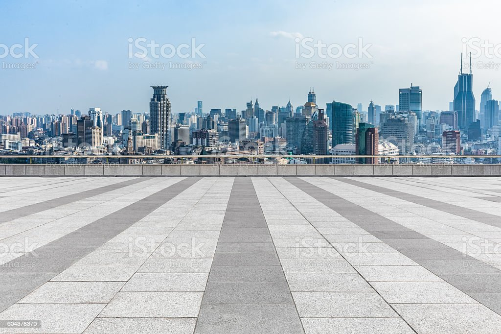 empty brick floor with city skyline background stock photo