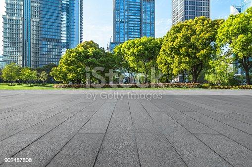 istock Empty brick floor with city skyline background 902487808
