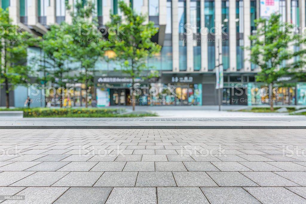 Empty brick floor with modern building stock photo
