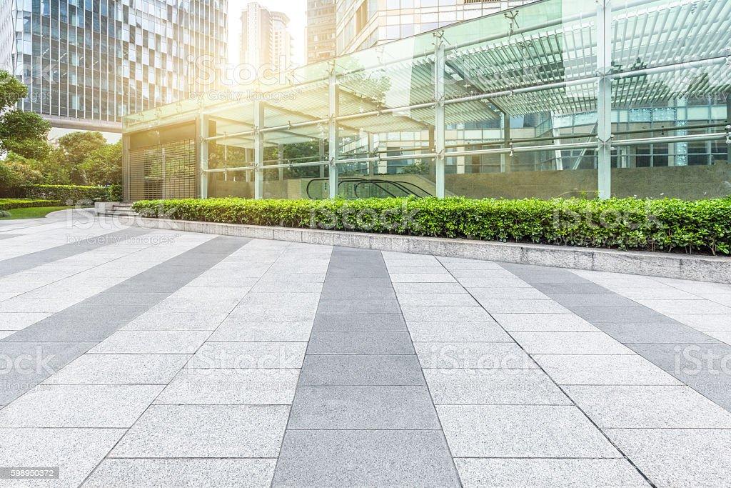 Empty brick floor with modern building – Foto