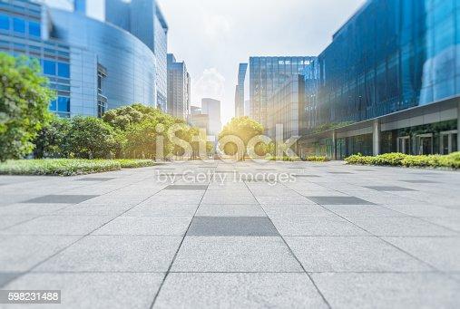 istock Empty brick floor with modern buildings 598231488