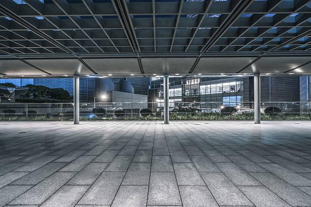 empty brick pedestrian walkway at night stock photo