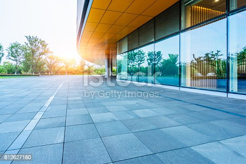 istock empty brick road nearby office building 612627160