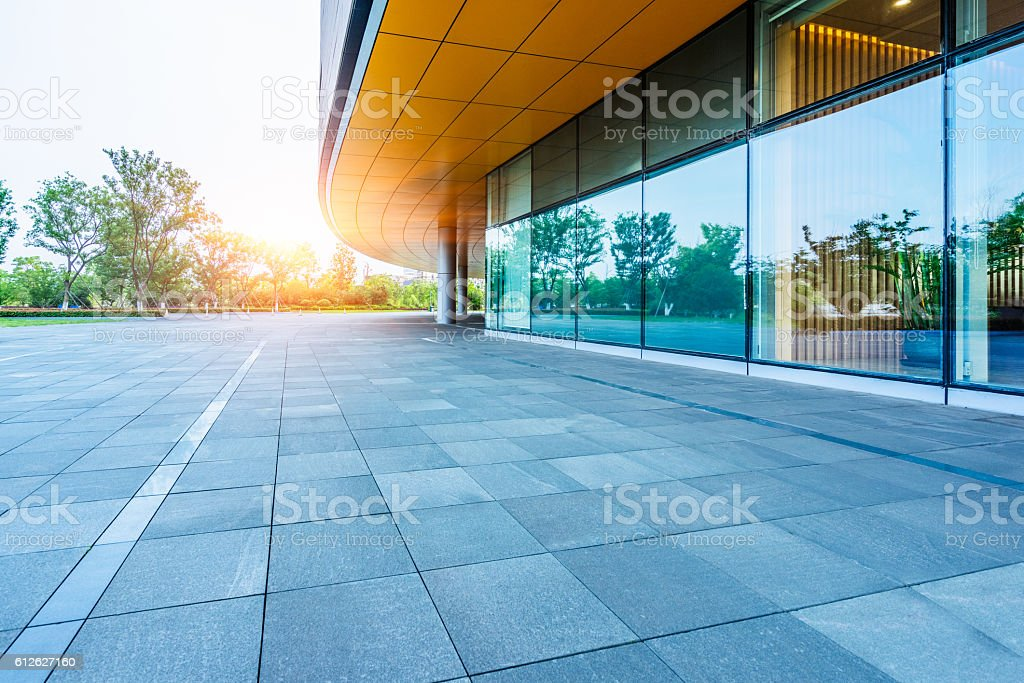 empty brick road nearby office building stock photo
