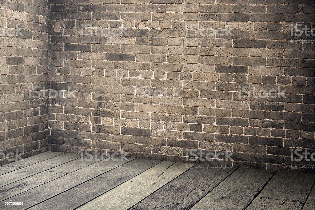 Empty brick wall and wood plank floor interior photo libre de droits