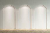istock Empty bright gallery with three arches with a spotlight. Front view. 1212347545