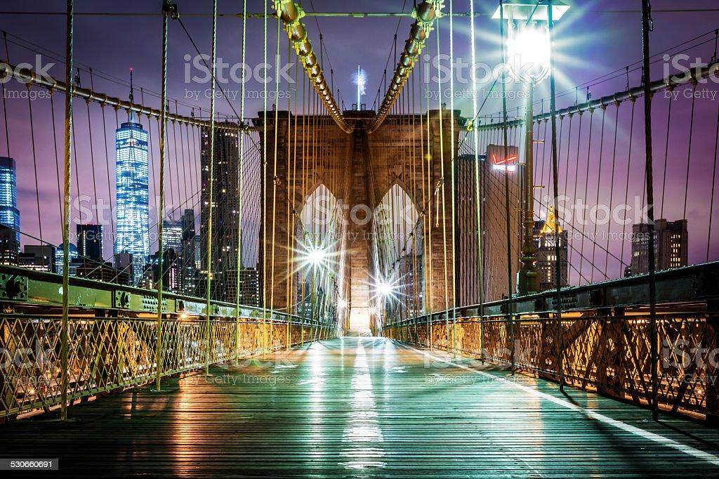 Empty Brooklyn Bridge pedestrian walkway before sunrise stock photo