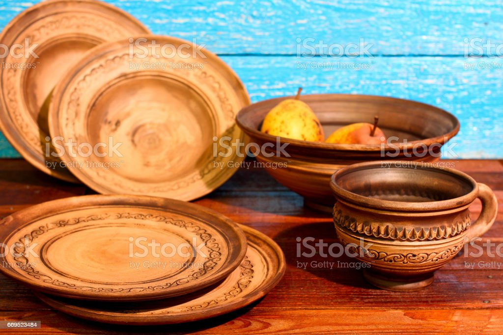 Empty Brown Clay Plates Bowls Mug With Ornament Pattern On A Blue Wooden Background Ukraine Stock Photo Download Image Now Istock