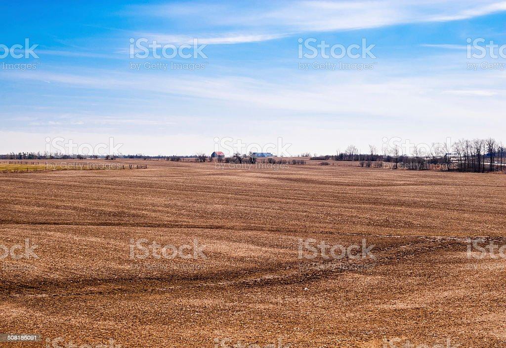 Empty brown farm fields on sky stock photo