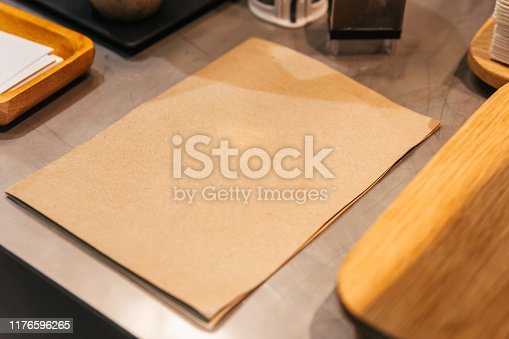 947207308istockphoto Empty brown paper cover menu place on coffee kitchen counter. 1176596265