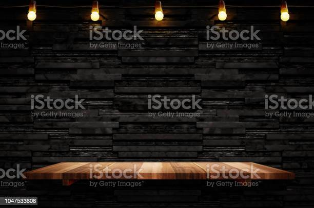 Empty brown plank wood shelf at black layer marble tile wall up for picture id1047533606?b=1&k=6&m=1047533606&s=612x612&h=v1iv5atklabqkk8dfrocyqxoa6suck8l0n9zdpcvims=
