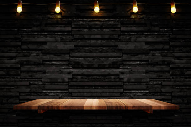 empty brown plank wood shelf at black layer marble tile wall background,mock up for display or montage of product or design - bar zdjęcia i obrazy z banku zdjęć