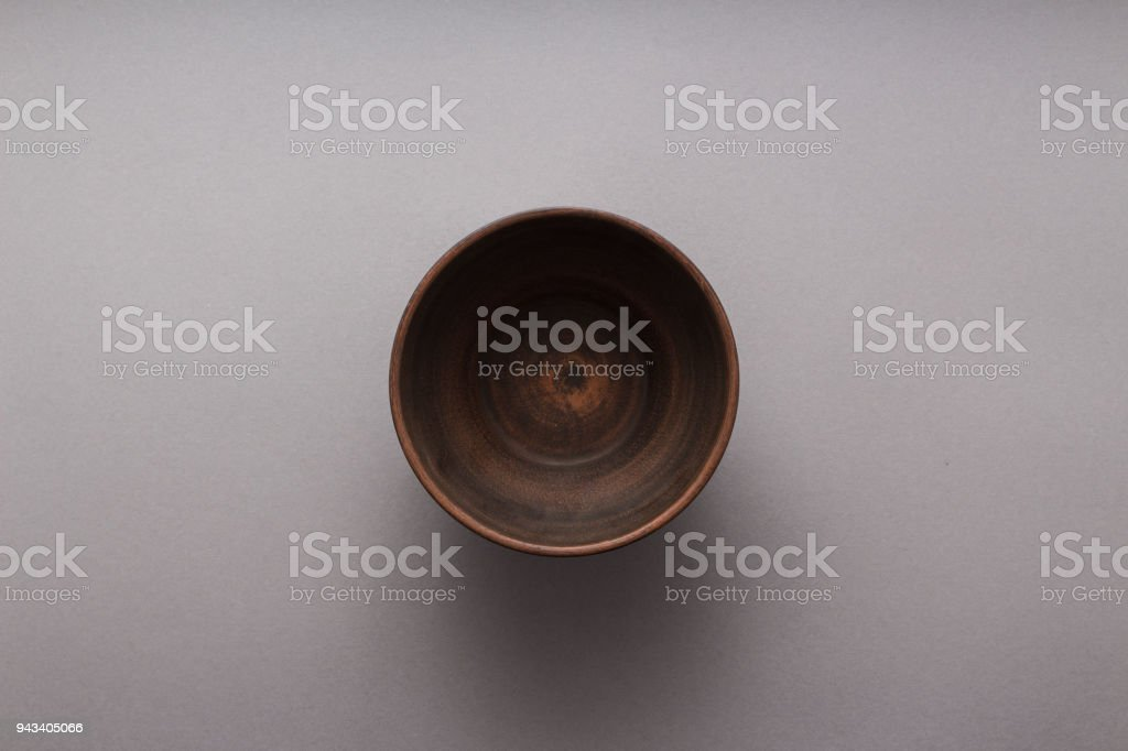 Empty brown plate on grey background, top view, flat lay stock photo
