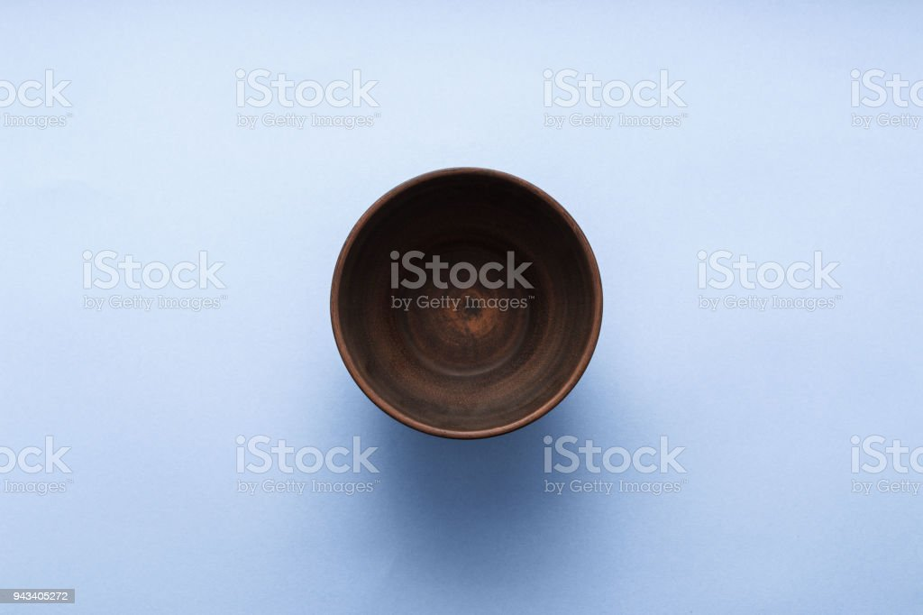 Empty brown plate on pastel blue background, top view, flat lay stock photo