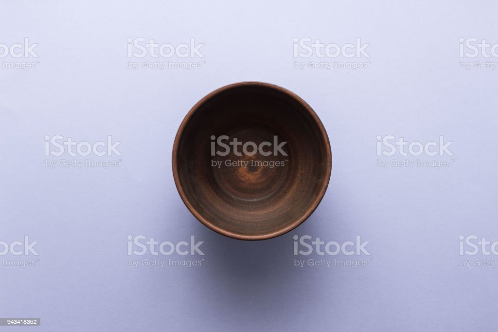 Empty brown plate on pastel purple background, top view, flat lay stock photo