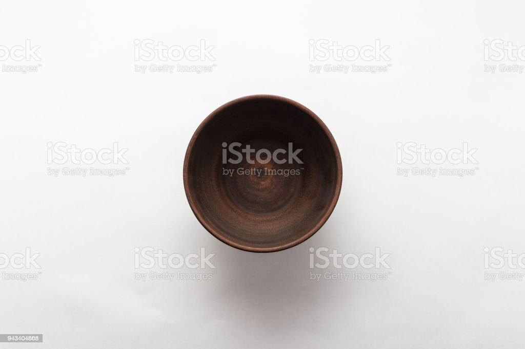 Empty brown plate on white background, top view, flat lay stock photo