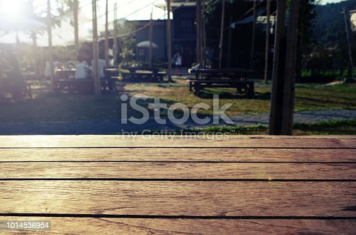 istock Empty brown wooden table and blur background of resturant lights ,can be used for montage or display your products with copy space 1014536954