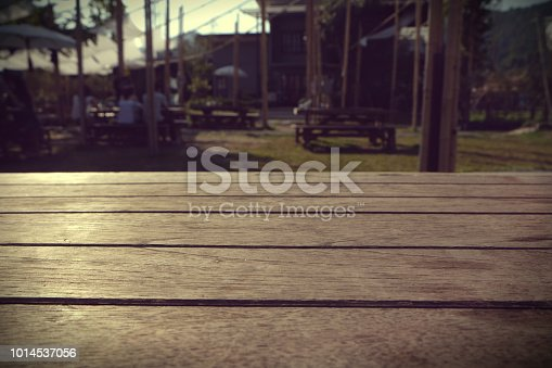 istock Empty brown wooden table and blur background of resturant lights ,can be used for montage or display your products with copy space 1014537056