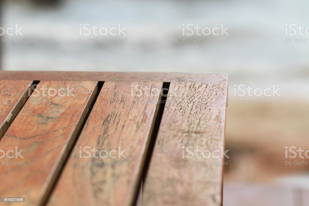 empty brown wooden texture table for restaurant, website, picture frame advertising chart board with sea nature background stock photo