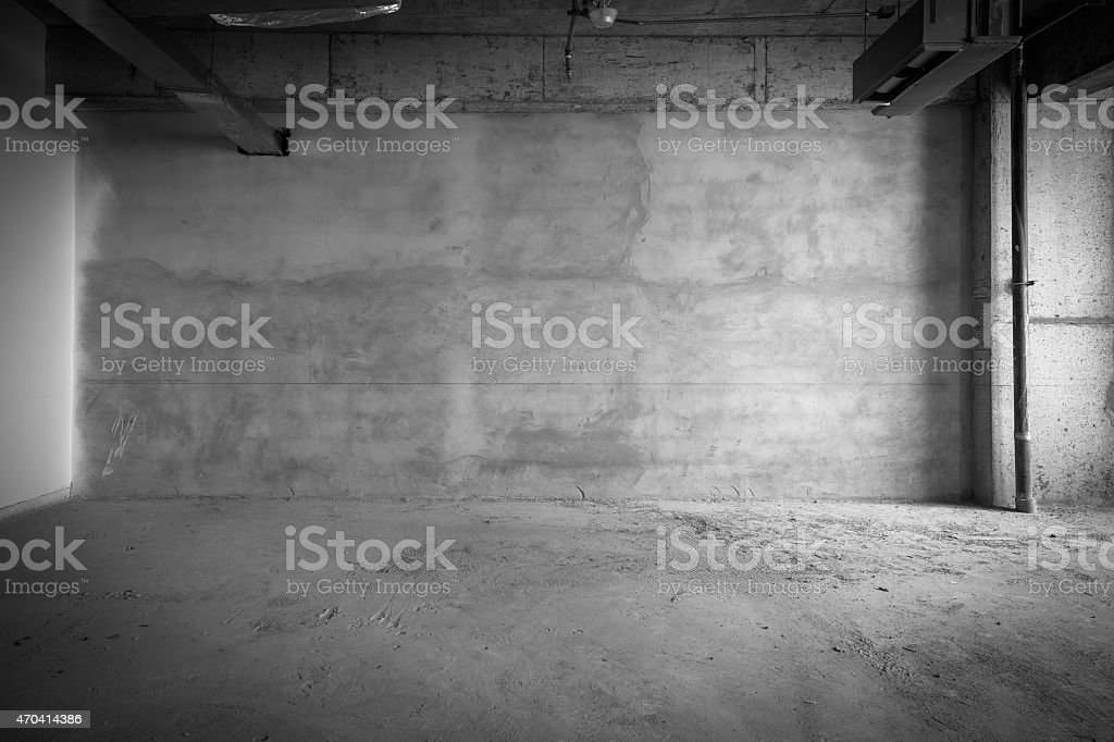 Empty building interior with concrete floors and walls stock photo