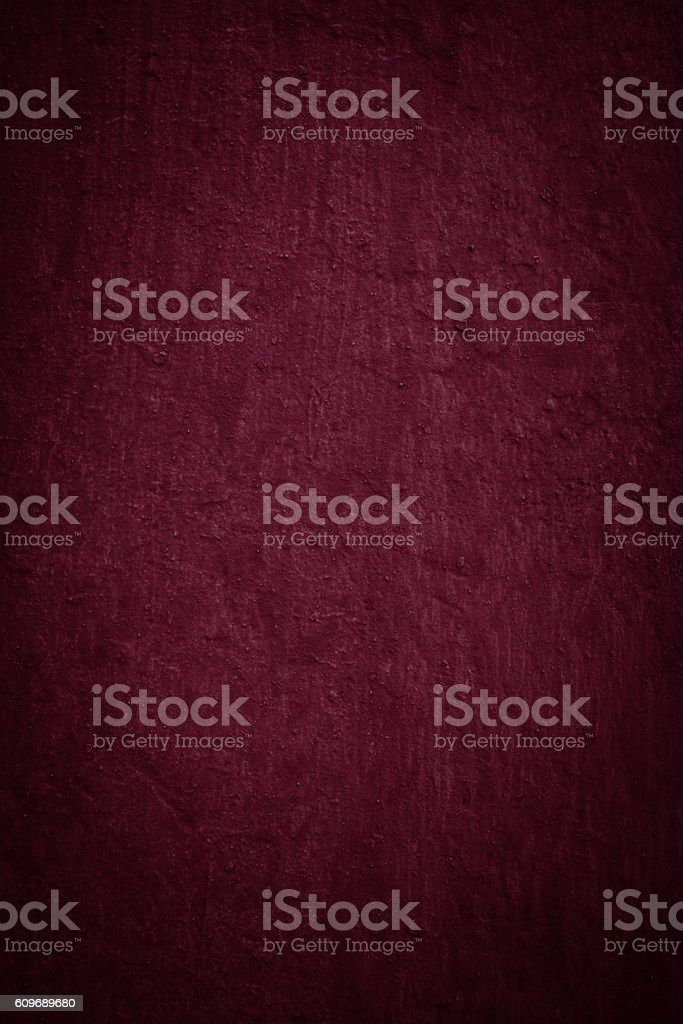 empty burgundy colored old plaster texture. stock photo