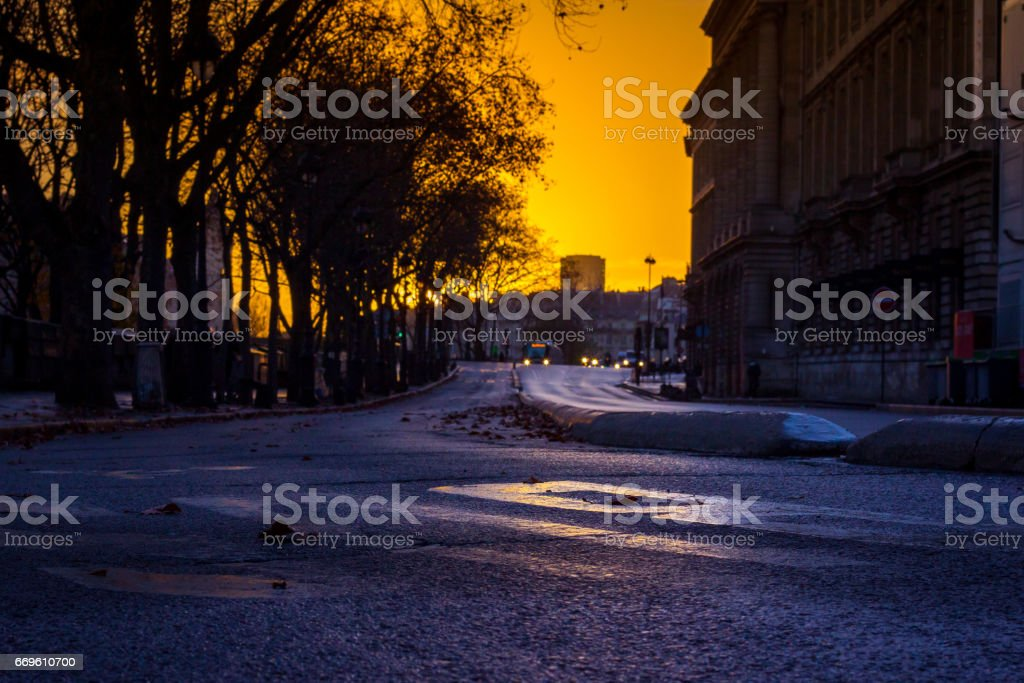 Empty bus lane in front of the Institut de France at Sunrise stock photo