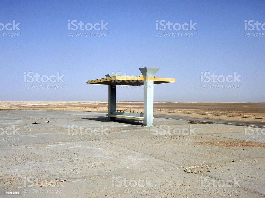 Empty bus stop in Egyptian desert stock photo