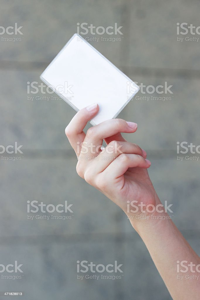Empty business card in a woman's hand royalty-free stock photo