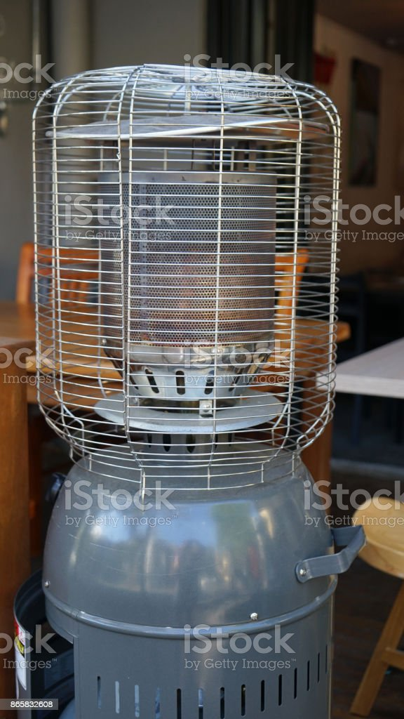 Empty cafe gas heater at midday stock photo