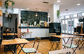 istock Empty cafe interior with chairs and tables 1286692956