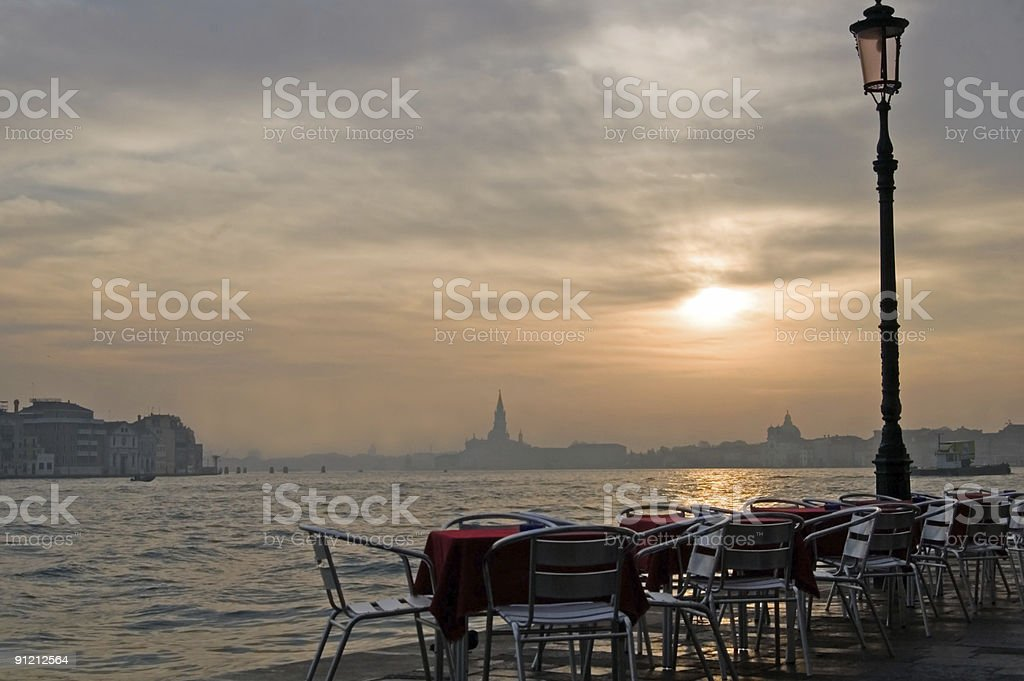 Empty Cafe Tables at Sunrise stock photo
