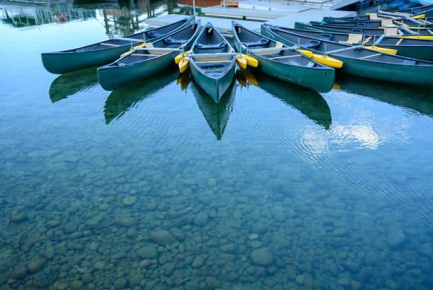 Empty Canoes in Jenny Lake stock photo