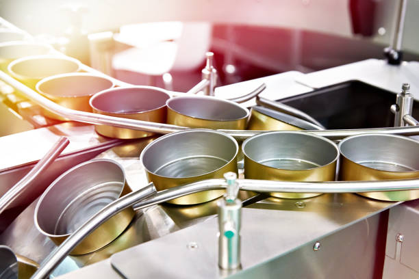 Empty cans on conveyor of food factory stock photo